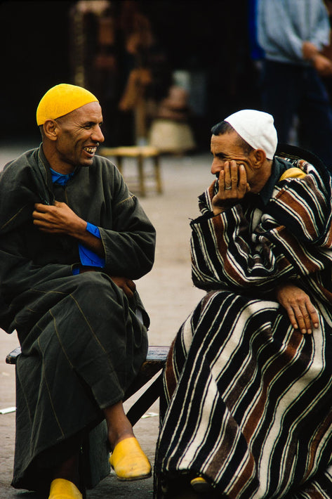Two Seated Men Smiling and Talking, Marrakech