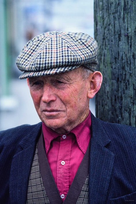 Man with Cap, Maroon Shirt, Ireland
