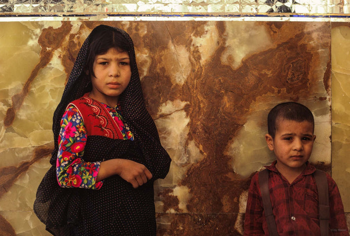 Boy and Girl Against Onyx Wall, Iran