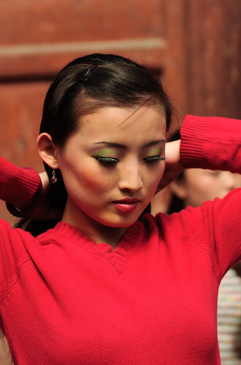 Close-up, Girl in Red Adjusting Hair, Pingyao