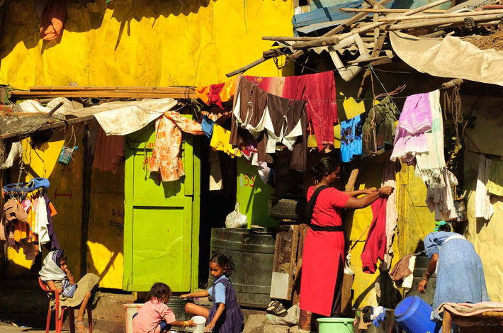 Woman in Red Against House with  Laundry, Mumbai
