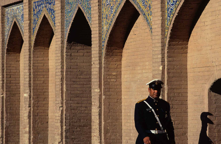 Policeman on Bridge with Bizarre Shadow, Iran