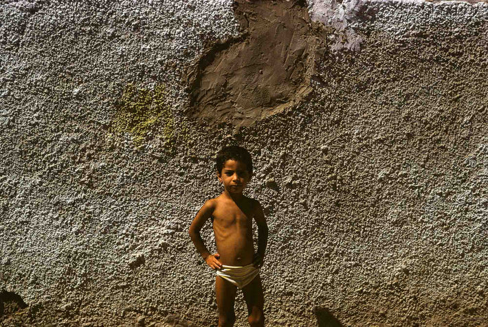 Child, Hands on Hips Against Textured Wall, Marrakech