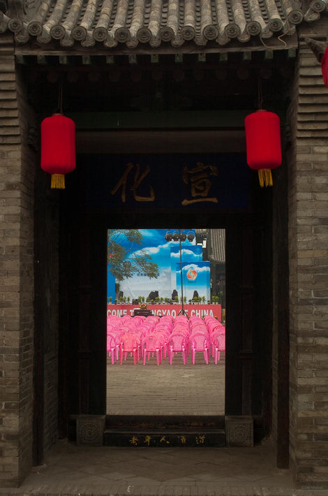 Looking Through Old Door at Pink Chairs, Pingyao