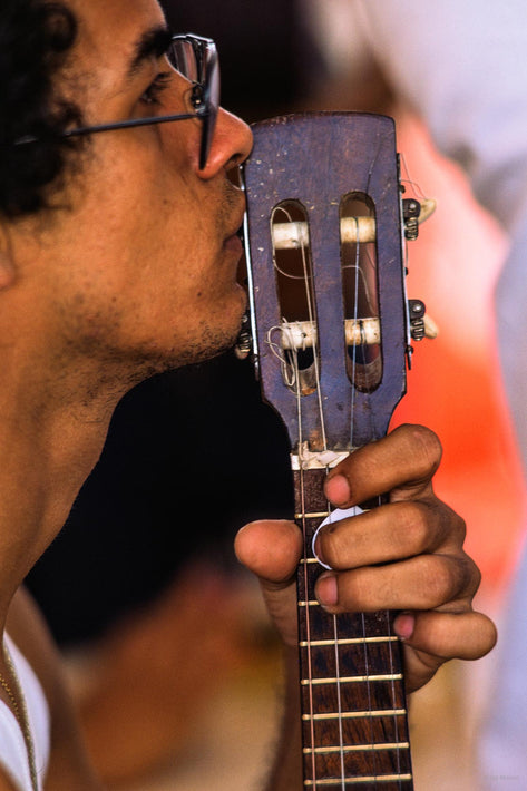 Man with Guitar Held up to Face, Profile, Bahia