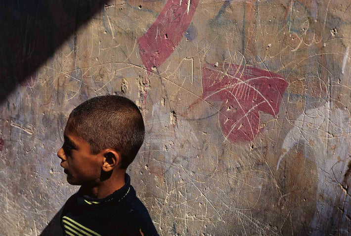 Boy's Head Against Graffiti, Iran