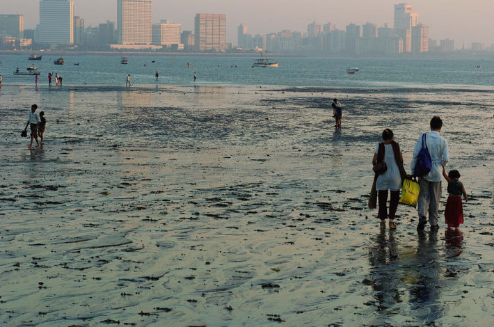 Family Walking on Muddy Beach, Mumbai