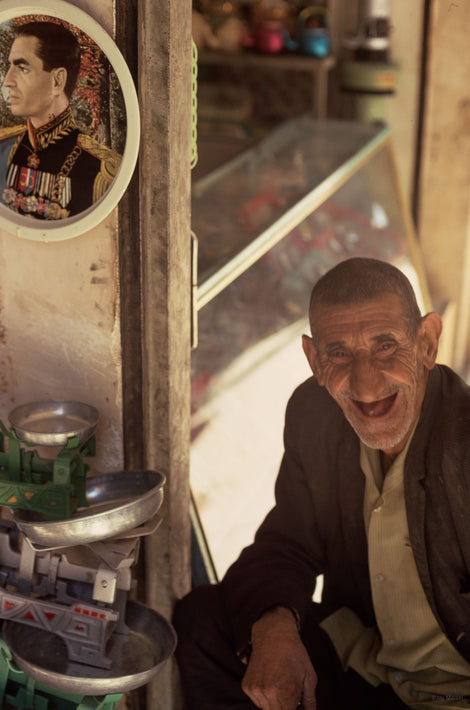 Old Man Laughing with Portrait of Shah in Background, Iran