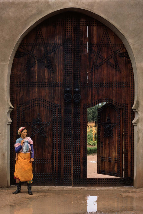 Woman with Baby's Leg Against Huge Door, Marrakech