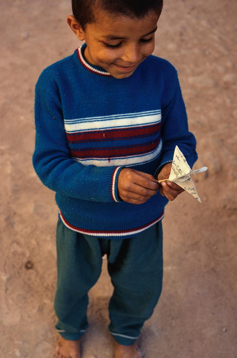 Boy with Paper Airplane, Iran