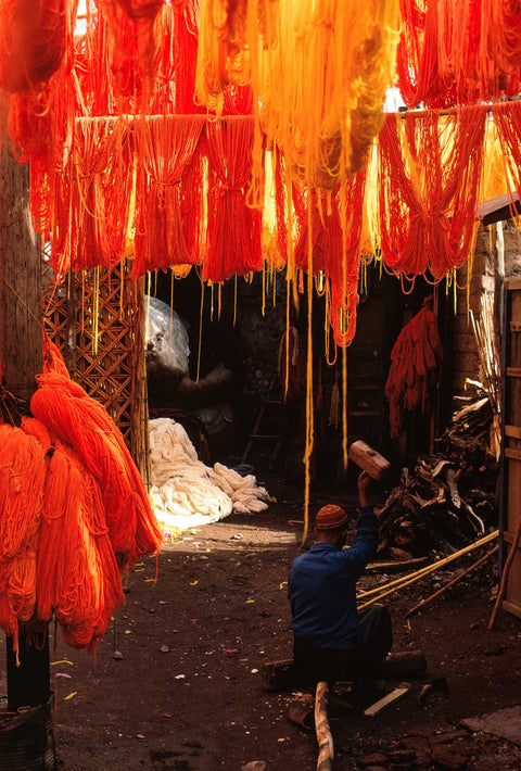Man with Raised Hammer, Orange Skeins Overhead, Marrakech