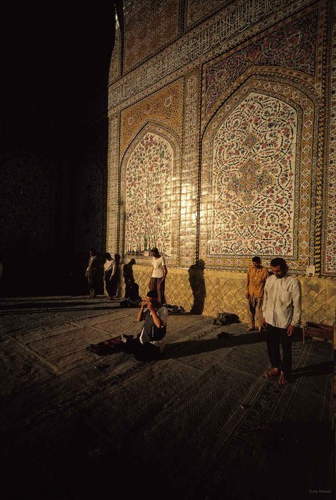 Men in Prayer with Sunlit Tiled Wall in Background, Iran