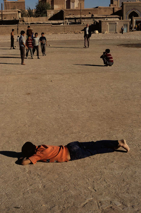 Boy Laying on Ground, Iran