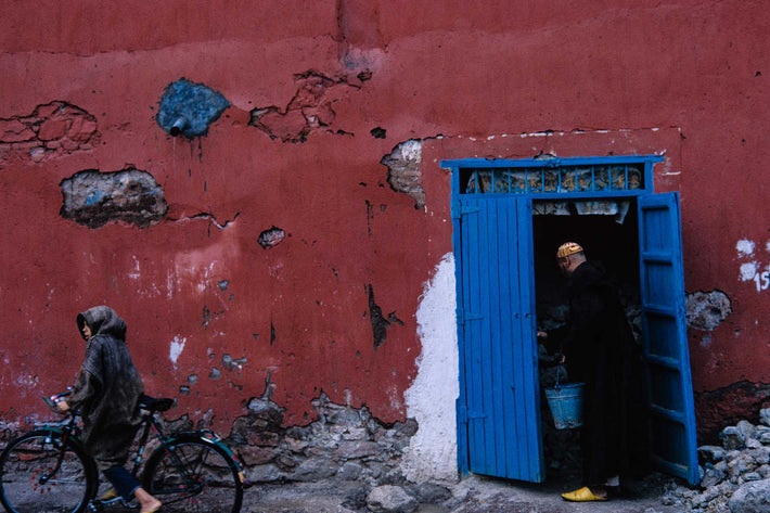 Man in Blue Doorway and Young Boy on Bike, Marrakech