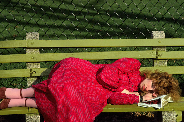 Woman Sleeping on Bench