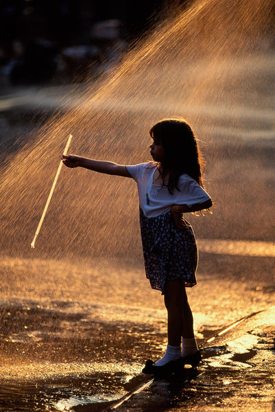 Girl Playing in Spray, NYC