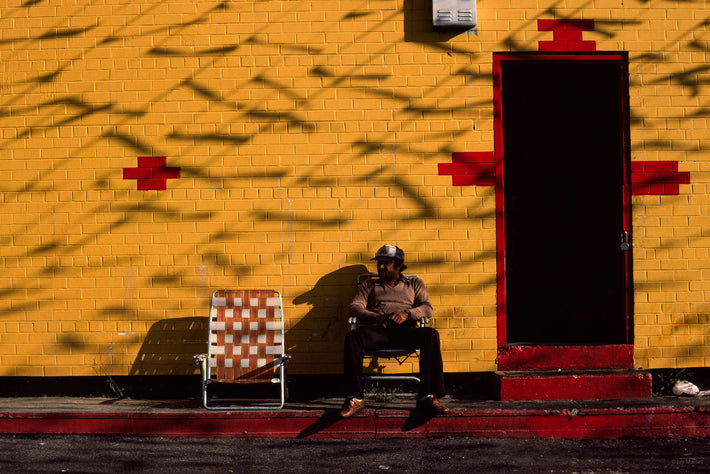 Man Sitting by Yellow Wall, NYC