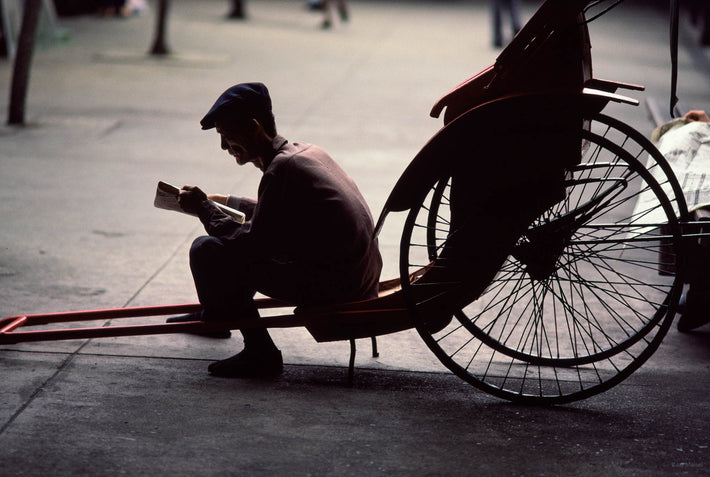 Rickshaw Man Reading, Hong Kong