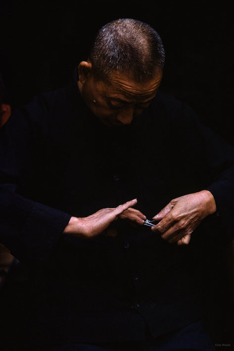 Man Clipping Nails