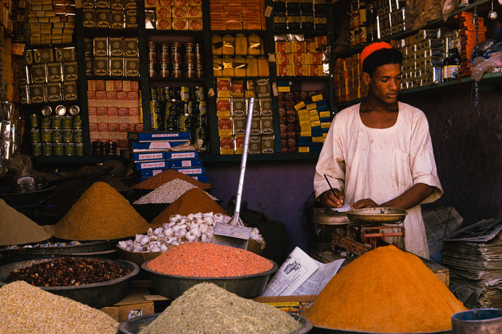 Man in Market, Piles of Grains and Spices