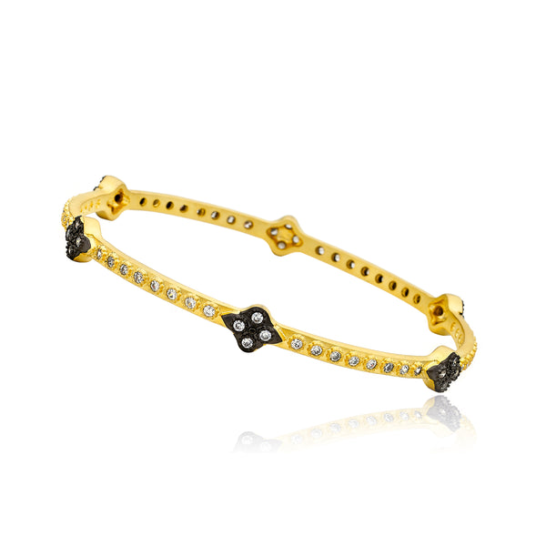 Cosmopolitan 14K Gold Plated Bangle With Cubic Zirconia's Accented With Black Rhodium Flowers