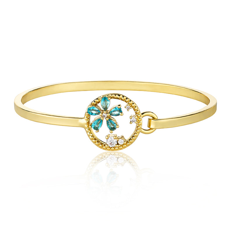 14k Gold Plated Cut Out Circle Bangle Accented With Aqua Daisy