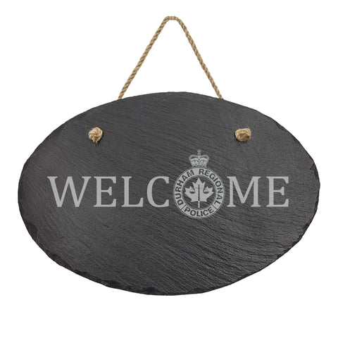 Durham Regional Police Oval Hanging Slate Decor - Slate Decor - 911 Duty Gear Canada - 911 Duty Gear Canada - Duty Patrol Gear and Gifts. Recessed Leather Badge Wallets and ID Holders, Neck & Belt Badge Holders, Notebook Cover for Evidence, Memo book, Triform Notepads for field interviews.