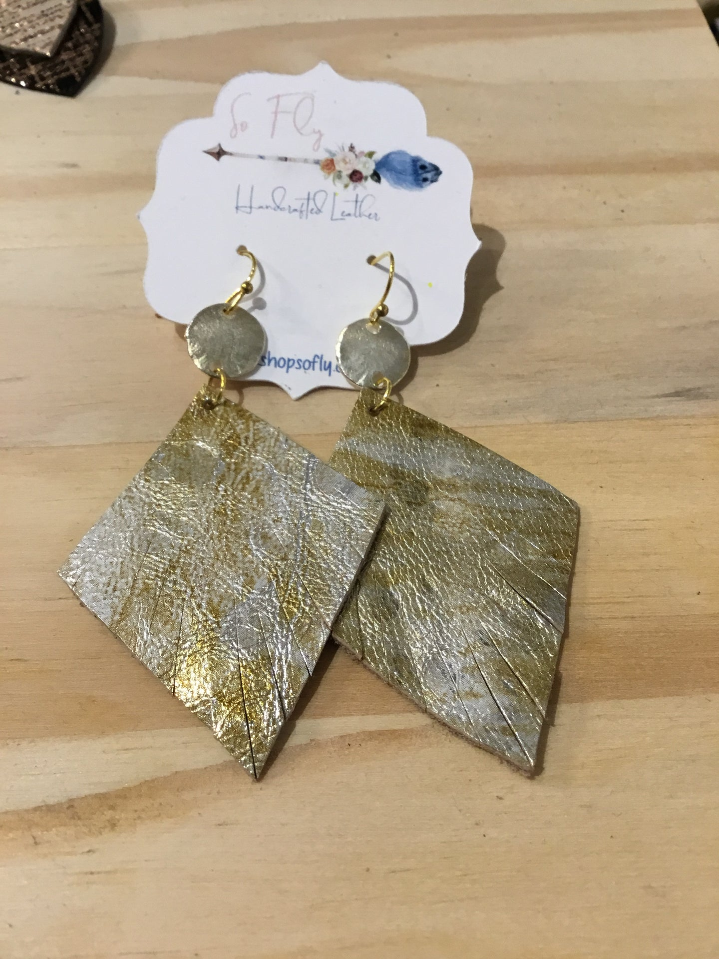 Silver and gold so fly earrings