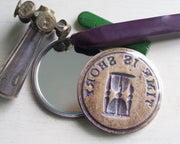 hourglass pocket mirror