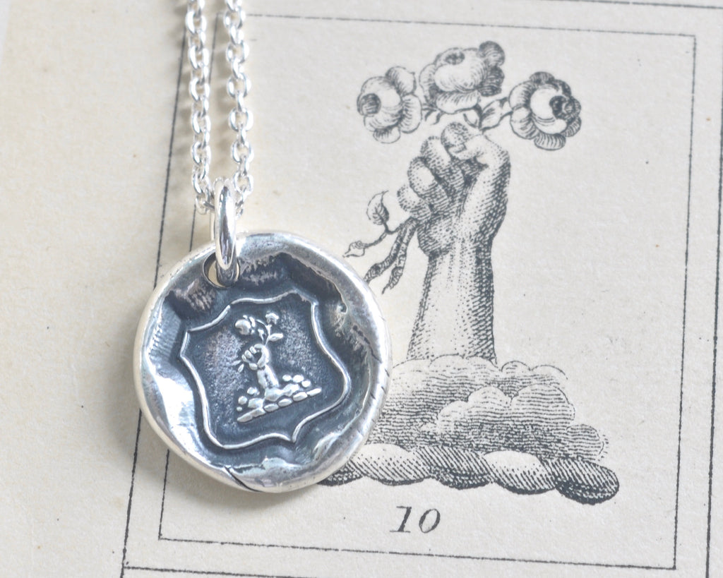 fist and flowers wax seal necklace