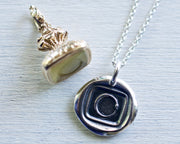 ouroboros wax seal jewelry