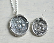 skull and crossbones memento mori wax seal necklace