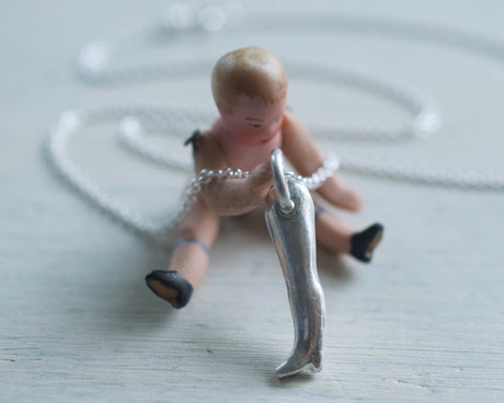 doll leg necklace