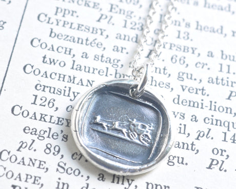 horse drawn carriage wax seal necklace