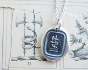 snake and axe wax seal necklace