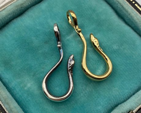 silver and gold serpent hooks
