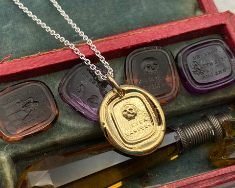 omnia vanitas skull wax seal jewelry