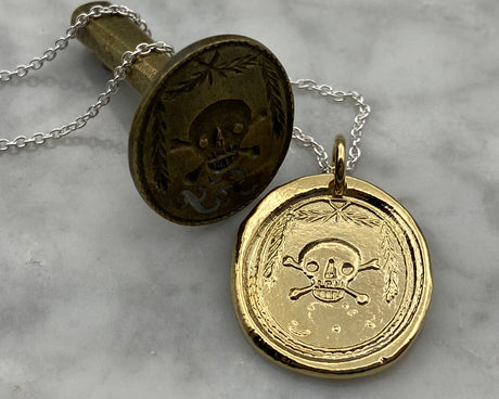 gold skull and bones wax seal necklace