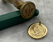 gold fleur de lis wax seal jewelry