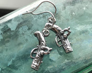 queen anne pistol earrings