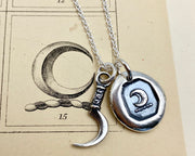 scythe and crescent moon necklace