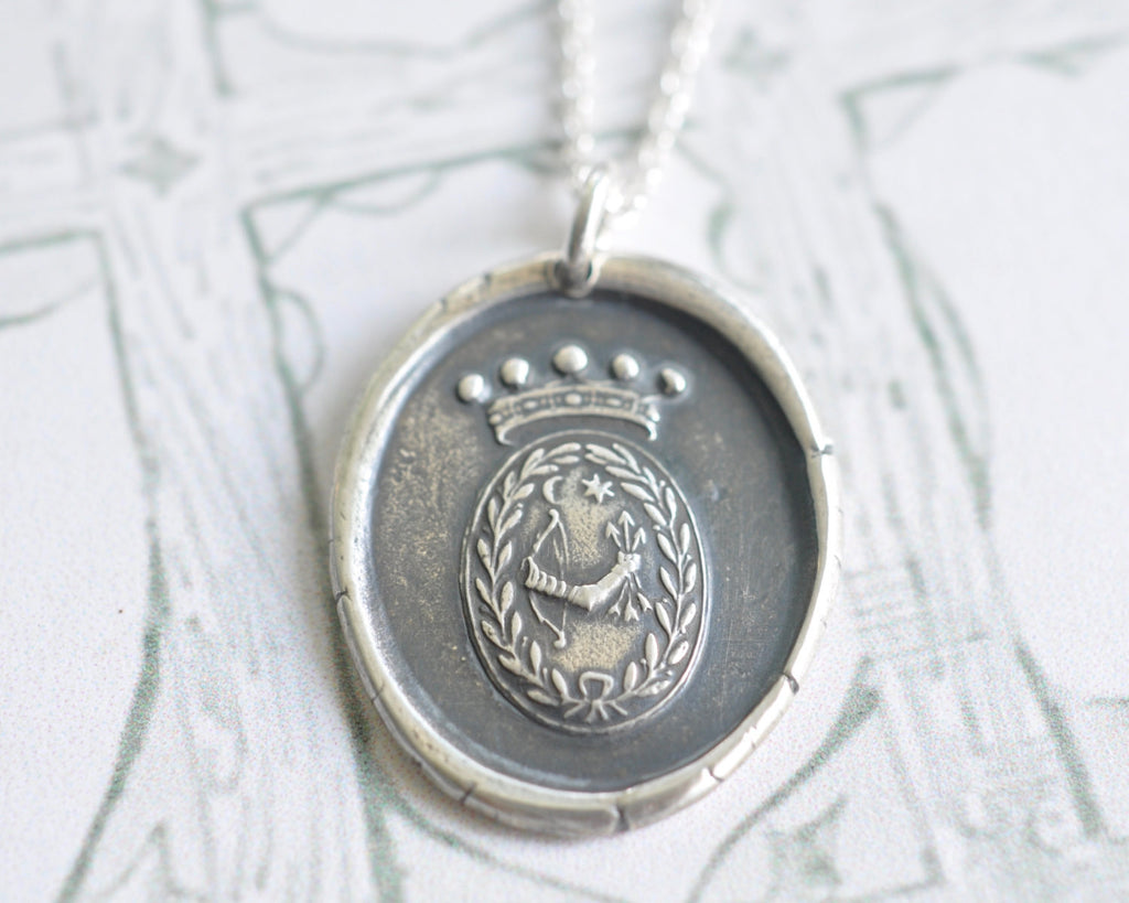 bow and arrow wax seal necklace