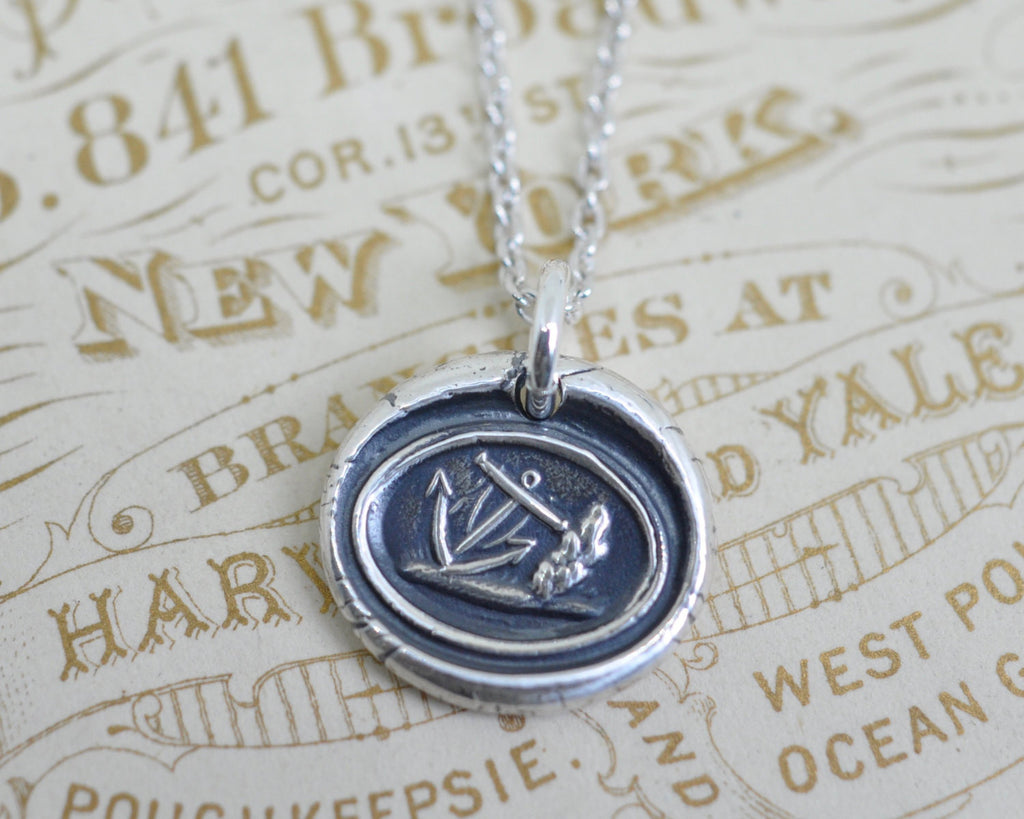 anchor leaning on a rock wax seal necklace