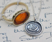 anchor leaning on a rock wax seal pendant