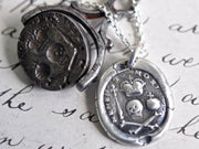 skull and bones wax seal necklace