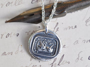 two swans wax seal necklace