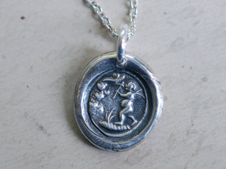 cupid mining a heart wax seal necklace