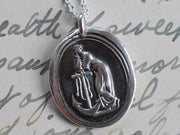 woman leaning on anchor wax seal pendant