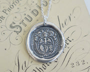 two hands wax seal necklace