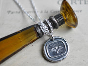 winged hourglass wax seal jewelry